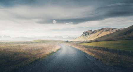 Icelandic landscape with asphalt road 写真素材