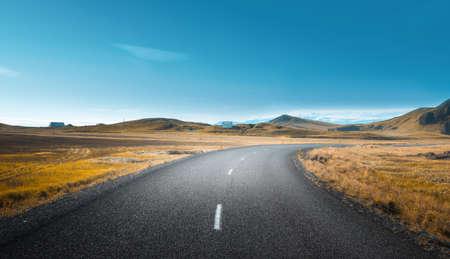 Icelandic landscape with asphalt road