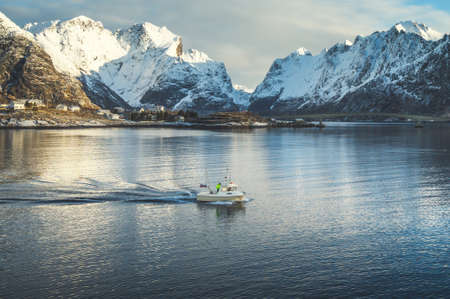 fishing boat and Reine Village, Lofoten Islands, Norway 写真素材