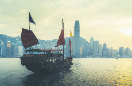 Hong Kong harbor in sunset time 写真素材 - 155598607