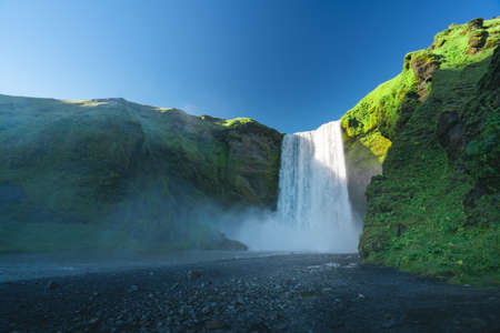 Skogarfoss waterfall and summer sunny day, Iceland