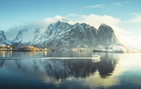 fishing boat and Reine Village, Lofoten Islands, Norway 写真素材