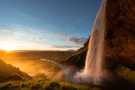 Seljalandfoss waterfall in sunset time, Iceland 写真素材