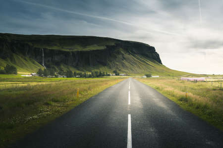 Icelandic landscape with asphalt road 写真素材