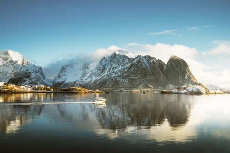 fishing boat and Reine Village, Lofoten Islands, Norway Reklamní fotografie