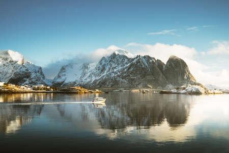 fishing boat and Reine Village, Lofoten Islands, Norway Foto de archivo
