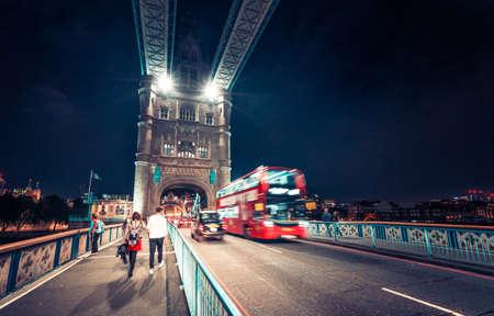night view of Tower Bridge traffic, London, UK
