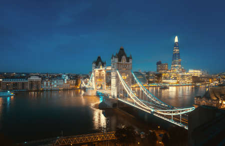 Aerial view to the Tower Bridge and skyline of London, UK