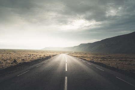Icelandic landscape with asphalt road Foto de archivo