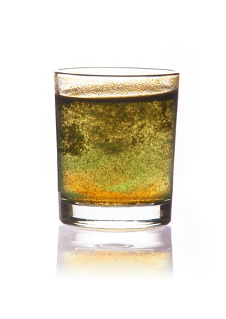pure water: toxic water in glass with turbid sediment, yellow and green color. isolated on the white background