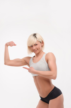 only the biceps: athletic girl showing their biceps on white isolated background