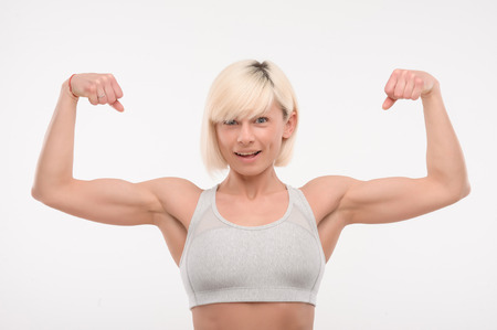 only the biceps: beautiful sports girl showing their biceps on white isolated background Stock Photo