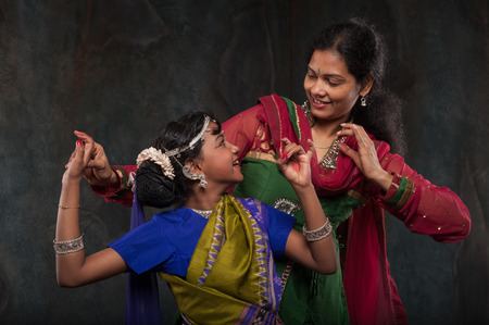 happy Indian family , mother instills daughter of folk culture