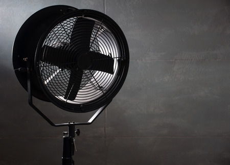 oscillate: professional equipment in the photo Studio. The fan on a black background. horizontal photo Stock Photo