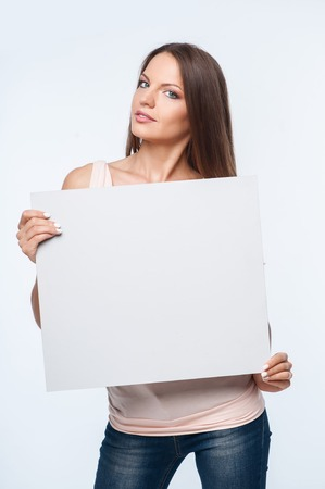 quadrant: Pretty woman is holding empty quadrant. She is looking forward seriously. Isolated on background Stock Photo
