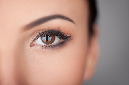 female sex: Close up of female eye. The lady is looking at the camera with desire. Isolated and copy space in right side Stock Photo