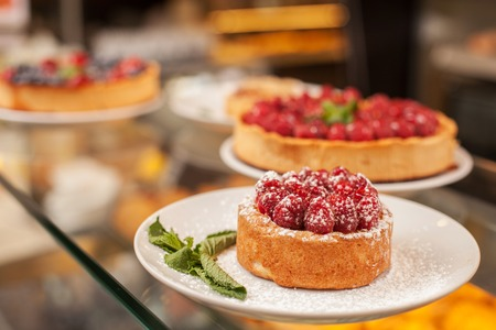bakery store: Close up of appetite pies are situated on display in bakery Stock Photo