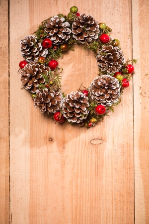 pine wreath: Marry Christmas. Christmas pine wreath is hanging on door
