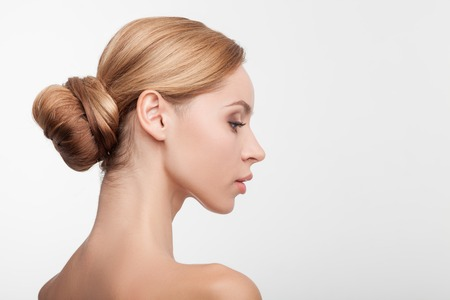 sex pose: Beautiful healthy woman is standing in profile. She is looking forward confidently and relaxing. Her skin is smooth and perfect. Isolated and copy space in right side