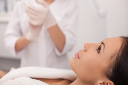 aging skin: Close up of arms of cosmetologist clapping her hands with joy. Stock Photo
