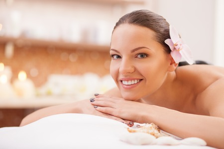 treatment: Beautiful young woman is getting skincare treatment at spa. Stock Photo