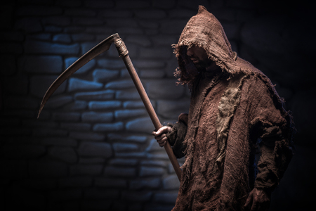 Grim Reaper is carrying a scythe and moving forward with threats