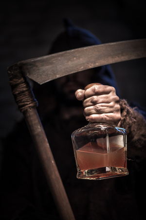 dreadful: Dreadful death character is holding a scythe. He is stretching forward the bottle of alcohol drink with threats