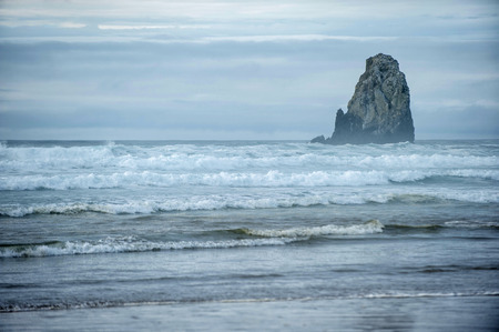 marvelous: Marvelous waves in Pacific Ocean are moving along Cannon Beach near Haystack Rock