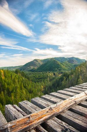 wood railway: Wonderful panorama of green mountains and sky in visible from the wood railway bridge