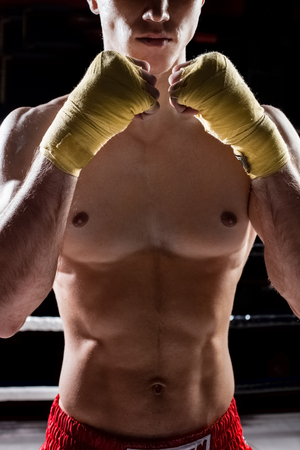 opponent: Cheerful boxing champion is fighting with his opponent. He is standing with confidence
