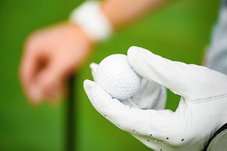 his: Today is his day. Close up of golf player hand holding ball on his hand Stock Photo
