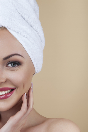 flawless: Analysing flawless beauty. Beautiful woman caressing her perfect skin isolated on brown background in studio