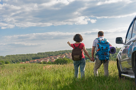 admiring: Adventure never ends. Young couple admiring view while out hiking during summer Stock Photo