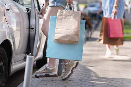 waist down: waist down view of a woman with bags