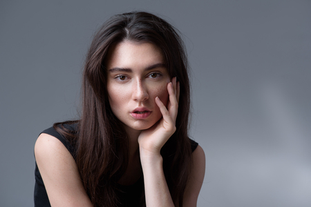 looking into camera: beauty and skincare concept, portrait of a calm woman thinking and looking into camera