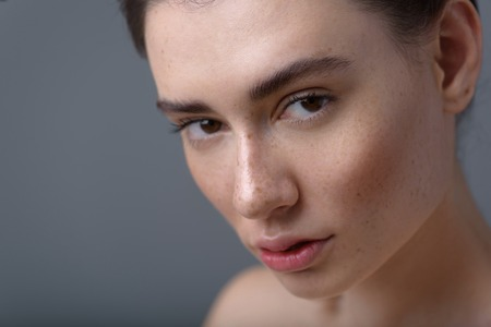 beautify: skin care concept, close up of a pretty woman with copy space Stock Photo