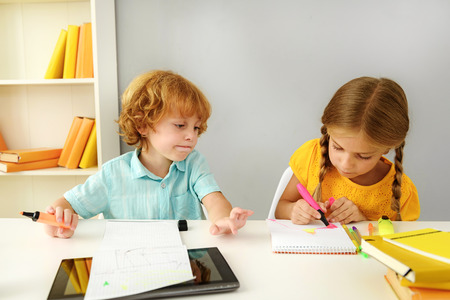 learning by doing: learning and next generation concept, children doing homework