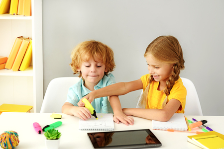 preschoolers: learning and next generation concept, modern preschoolers painting in front of digital tablet