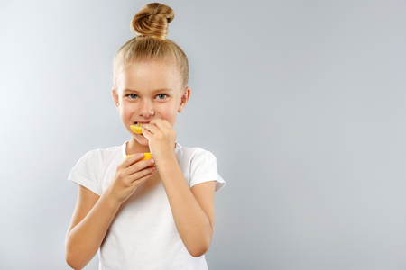 prophylaxis: prophylaxis and health care concept, kid holding lemon with copyspace