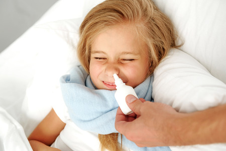 sickness and child care concept, girl lying in hospital Stock Photo