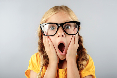 exited child in glasses with copy space 版權商用圖片