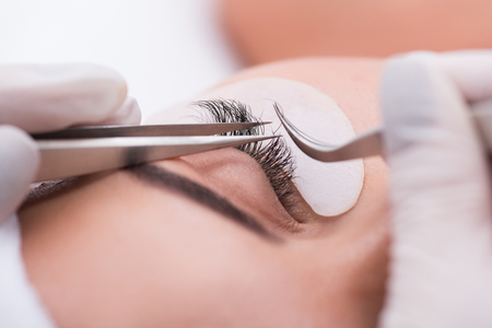 escalating: My favorite length. Cropped photo of eye of young woman with long eyelashes while escalating procedure in beauty salon
