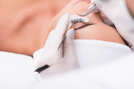 My perfect eyelashes. Cropped photo of beautiful young woman lying on couch in beauty salon during correction procedure