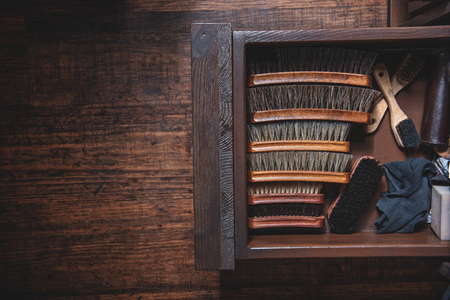 kit of horse brushes in the table with copy space