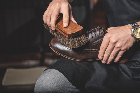 brogues: beautiful brogues being cleaned by a careful craftsman