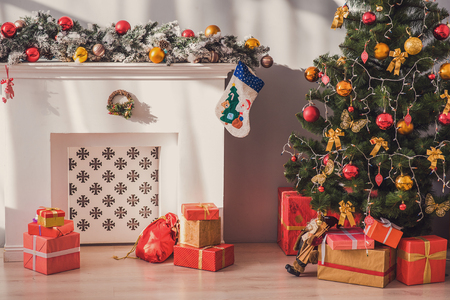 fireplace home: Beautiful Christmas tree, gift boxes and fireplace at home Stock Photo