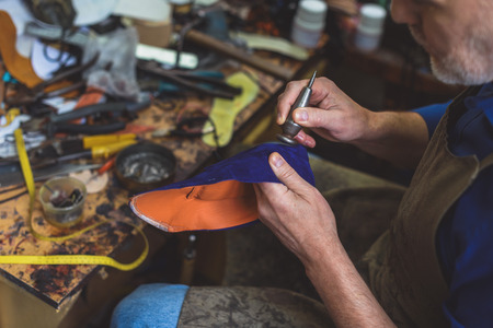 cobbler: cobbler smoothing angles of a shoe with a center punch