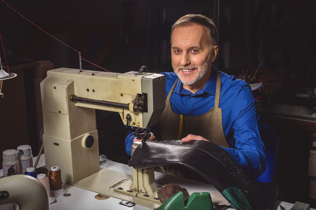 Smiling Cobbler Working On An Industrial Sewing Machine In A Stock Interesting Cobbler Sewing Machine