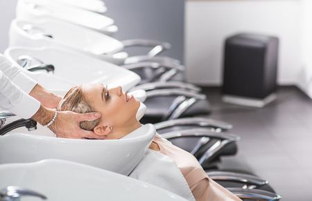 sudio: Calm girl is relaxing at hairdresser sudio