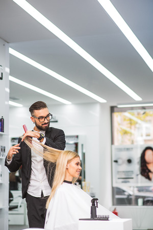 Professional stylist is talking to his client